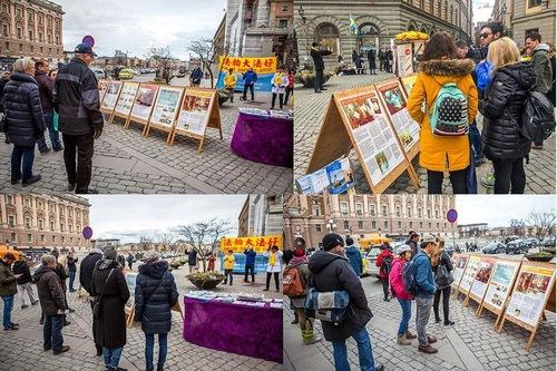 Люди читають інформаційні матеріали про Фалунь Дафа (Стокгольм, Швеція)